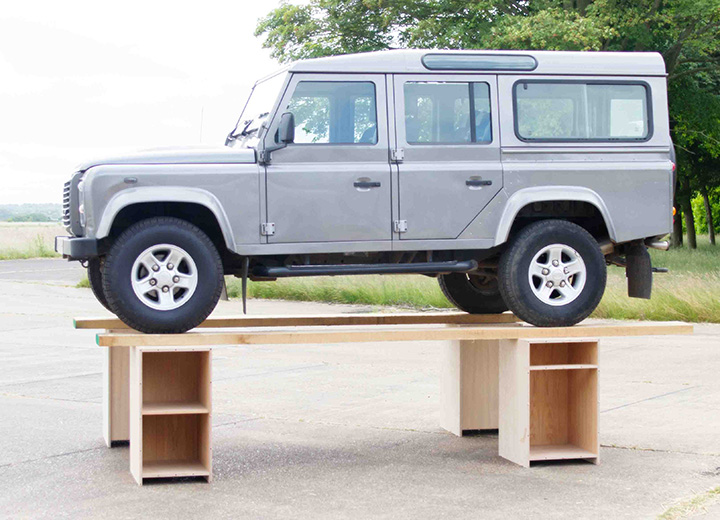 Side of Land Rover on bespoke kitchen cabinets